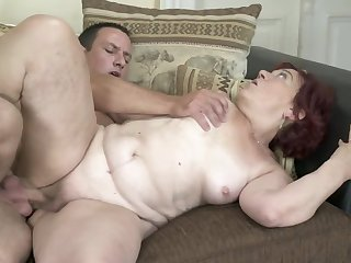 Red-haired granny finally gets her old twat banged firm