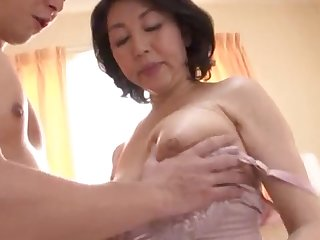 Japanese wife spreads her legs to be fucked by her younger darling