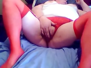 Nasty red haired BBW hooker is masturbating her twat for me
